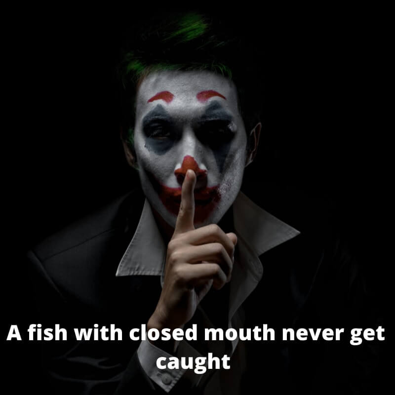 -a joker is showing to keep silent with his finger   BOOKMARK STATUS