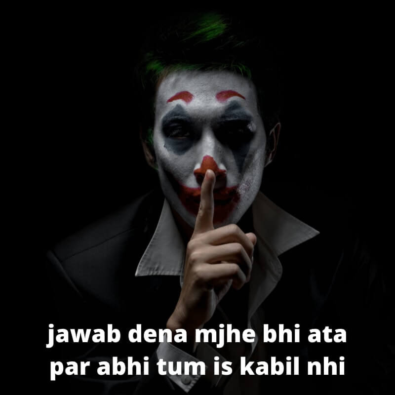 -a joker is showing to keep silent with his finger | BOOKMARK STATUS