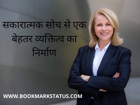 A well dressed women in black coat white shirt and black pant is standing with folded arms and she is smiling